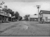 7 photo of main street with Polk's Grocery and Odd Fellows