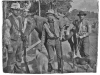 photo of 3 men, 2 dogs, and a horse with Winchester rifles and