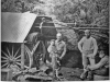 """photo of steam engine with writing on the back; """"Man to left is"""