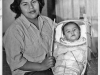 photo of Pomo woman and baby in traditional baby basket.