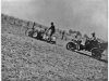 """photo of man on tractor with writing on back """"Henry Benson &"""