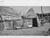 """"""" print of tule huts. Back says """"1950 at fair - built by Henry"""