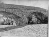 print of stone bridge across Napa River.