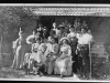 Negative of family grouping in front of cabin (Newman or